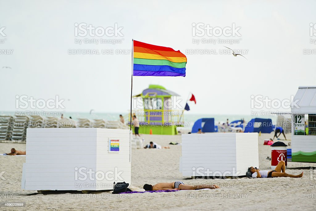 Gay Pride Flag on the Beach, USA royalty-free stock photo