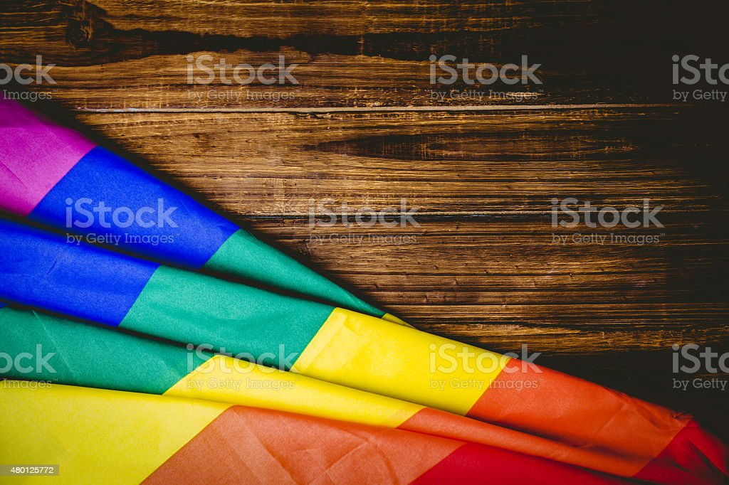 Gay pride flag on wooden table stock photo