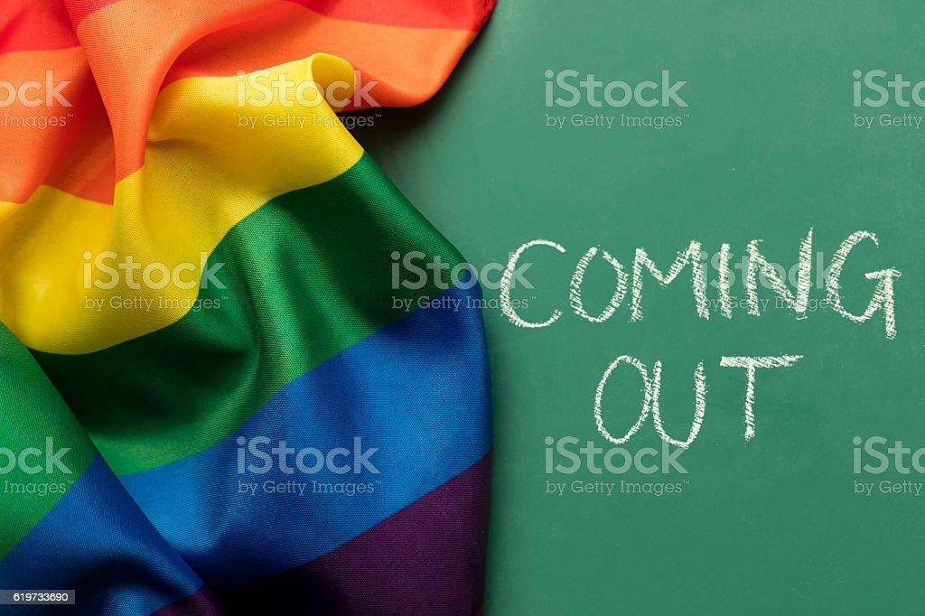 Gay pride rainbow flag on a chalkboard background stock photo