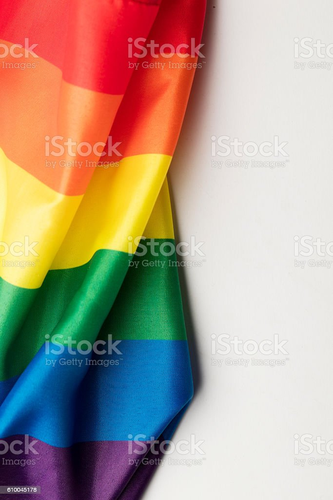 Gay pride rainbow flag on a plain background stock photo