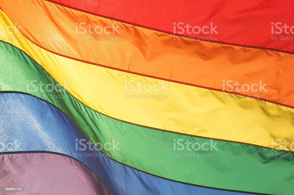 Gay Pride Rainbow Flag Shining in Bright Sunlight stock photo