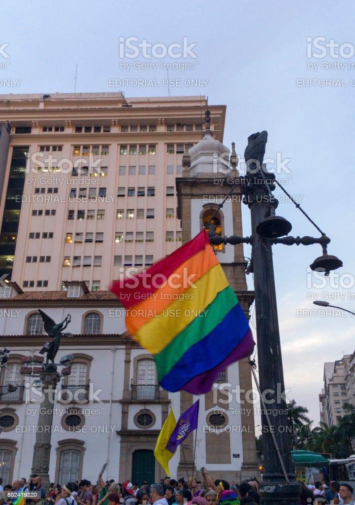 LGBT gay rainbow flag and church stock photo