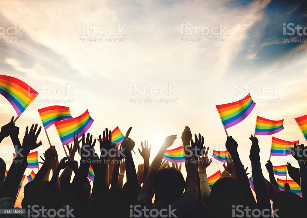 Gay Rainbow Flag Crowd Celebration Arms Raised Concept stock photo