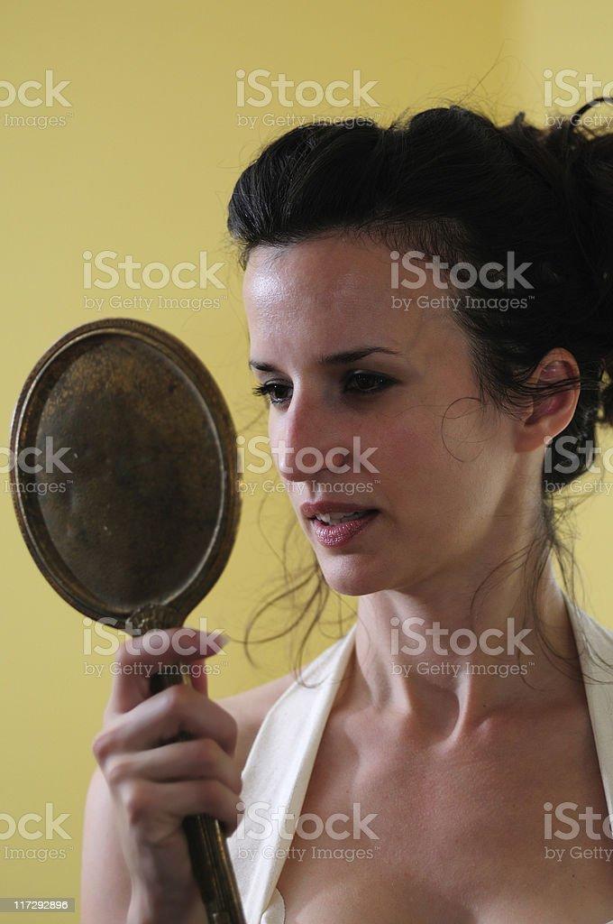 gazing into mirror royalty-free stock photo