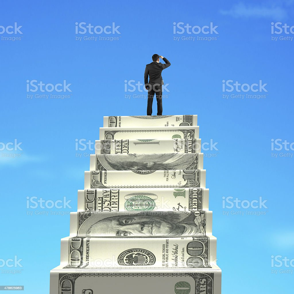 Gazing on top of money stairs stock photo
