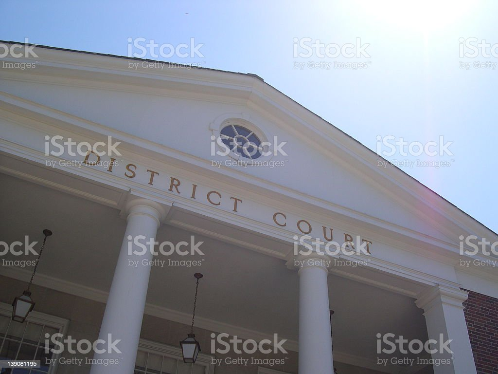 Gazing up at the pillars and roof of the district courthouse royalty-free stock photo