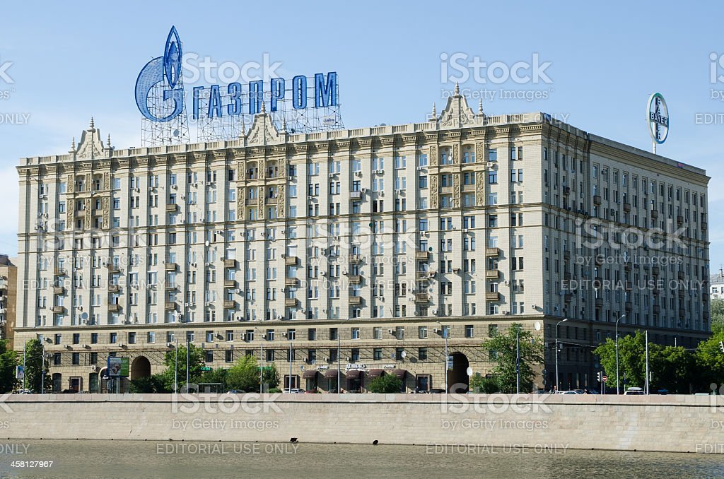 Gazprom logo on top of building on bank of river Moscow stock photo