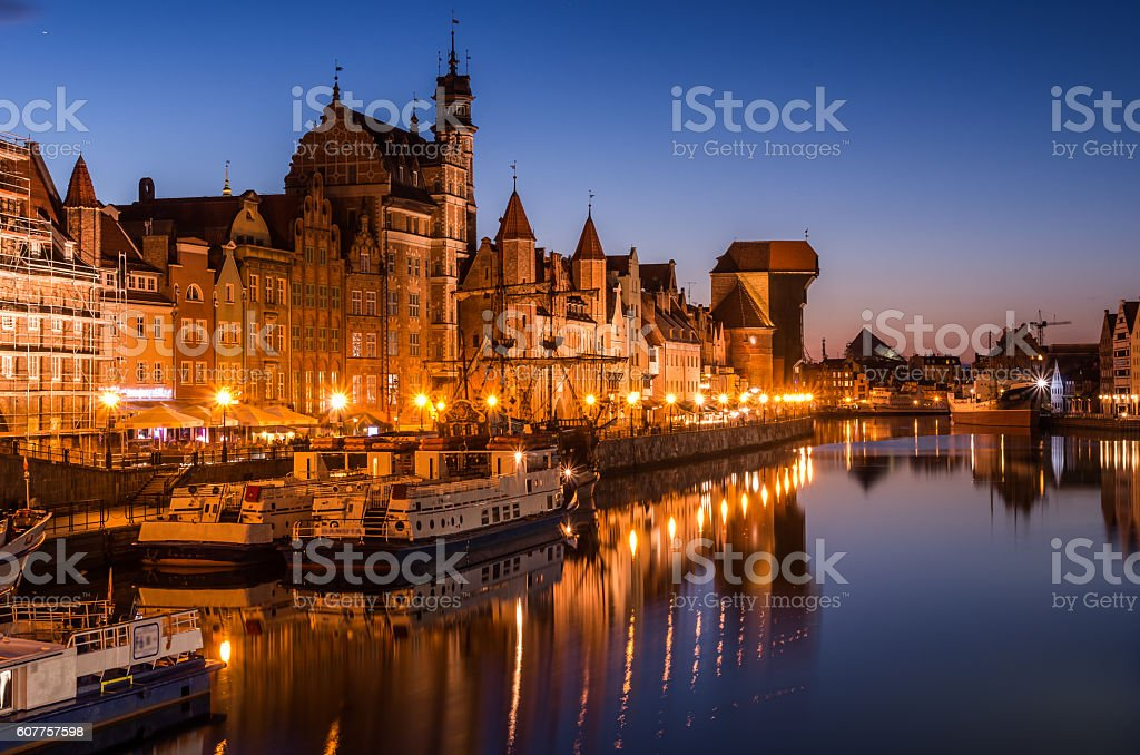 Gdansk old town with harbor and medieval crane night view stock photo