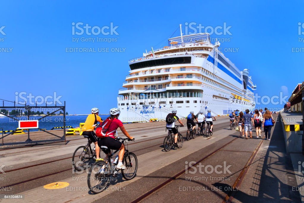 Gdynia, Poland - 07 28 2012: tourists on bikes returning back from the city trip to the big touristic cruise ship in the port of Gdynia stock photo