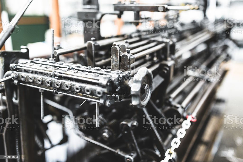 Gear machine part in action on a textile factory stock photo