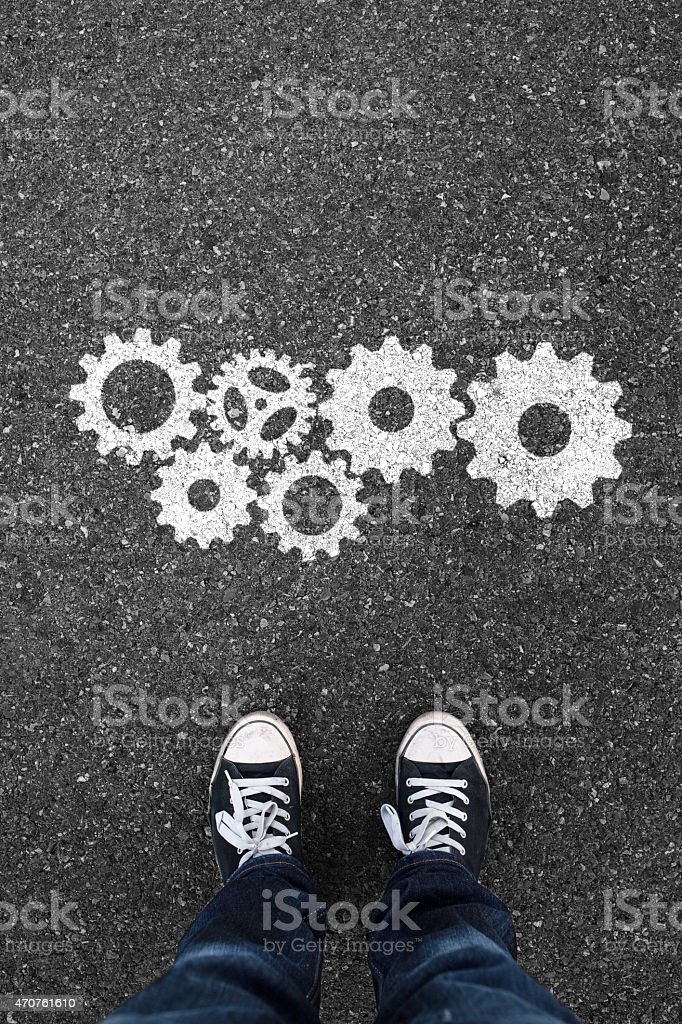 Gear shape on asphalt waiting people stock photo