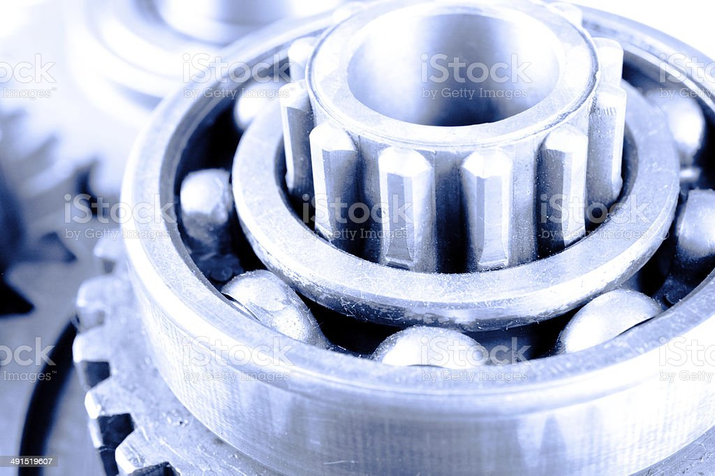 Gear transmission machine and steel cog wheels on isolated background royalty-free stock photo