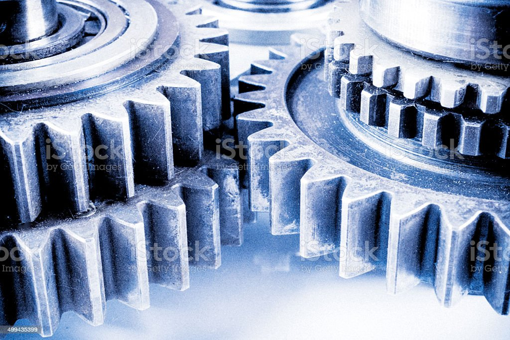 Gear transmission mechanics and steel cog wheels in macro photo stock photo