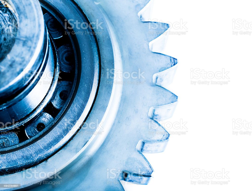Gear transmission mechanics and steel cog wheels on isolated background royalty-free stock photo