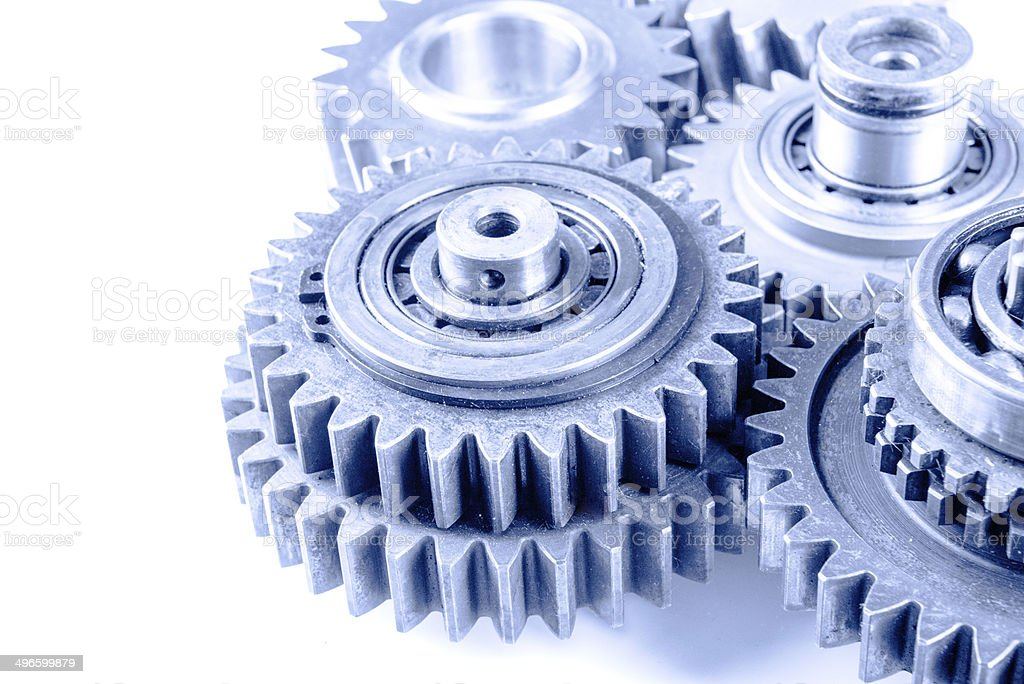 Gear transmission mechanics and steel cog wheels on isolated background stock photo