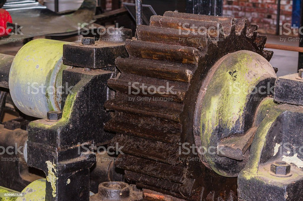 Gear wheel of an ancient antique machine. stock photo
