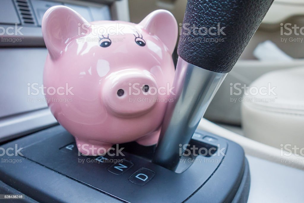 Gearbox with piggy bank stock photo