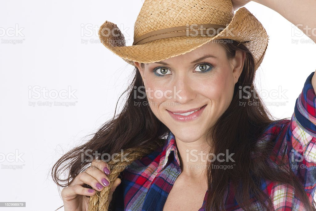 Geared Up Rancher's Daughter Cowgirl Rope Secures Straw Hat royalty-free stock photo