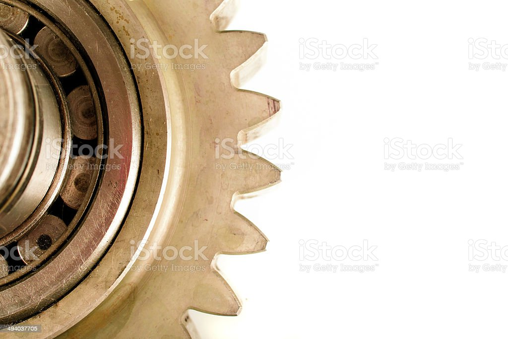 Gearwheel transmission mechanics and steel cog wheels on isolated background stock photo