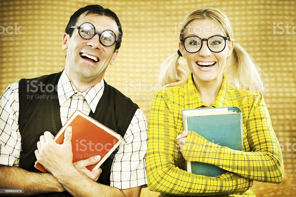 Gee couple holding books. royalty-free stock photo