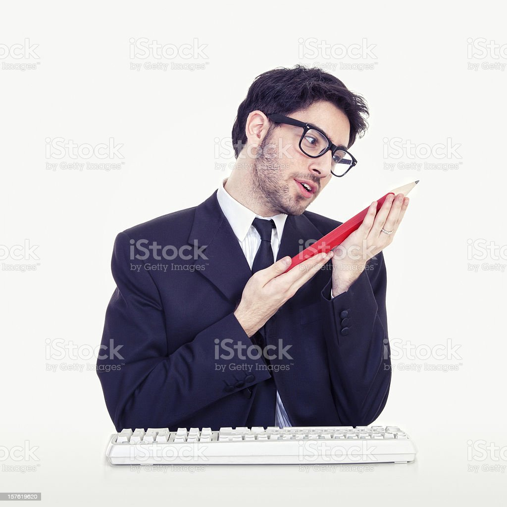 Geek businessman holding big pencil stock photo