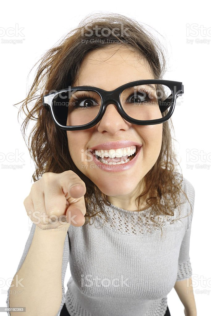 Geek girl pointing at camera stock photo