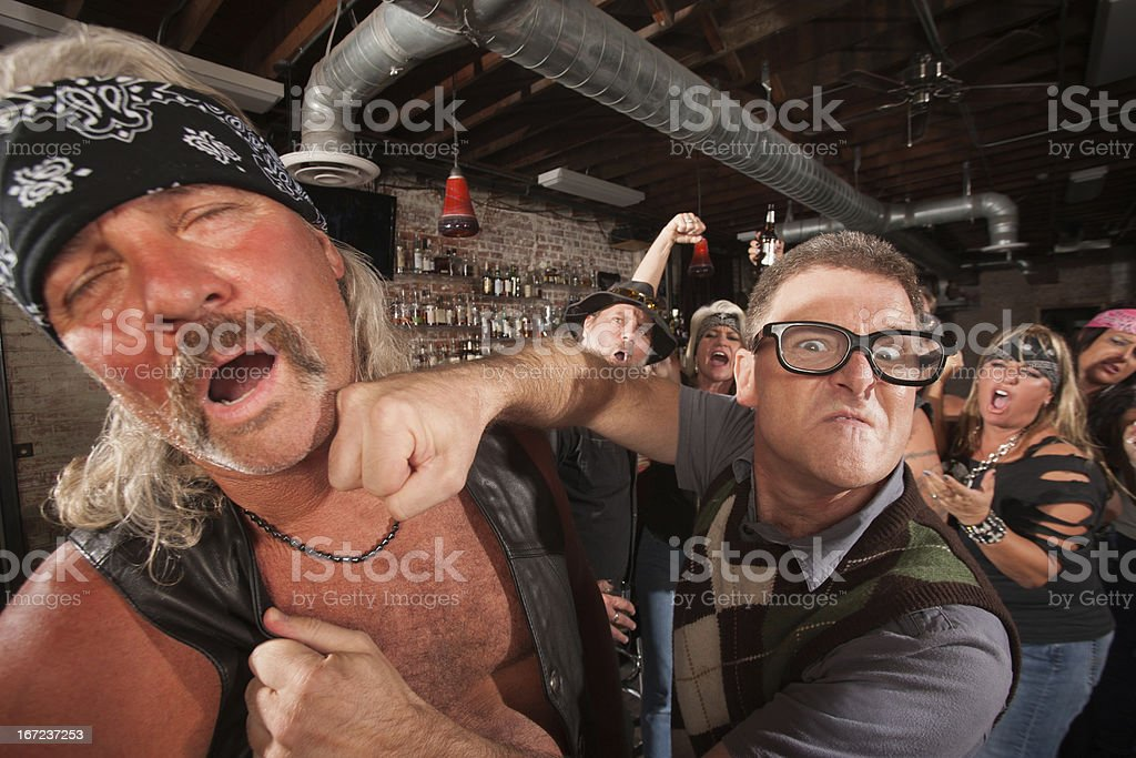 Geek Punches Man in Bar stock photo