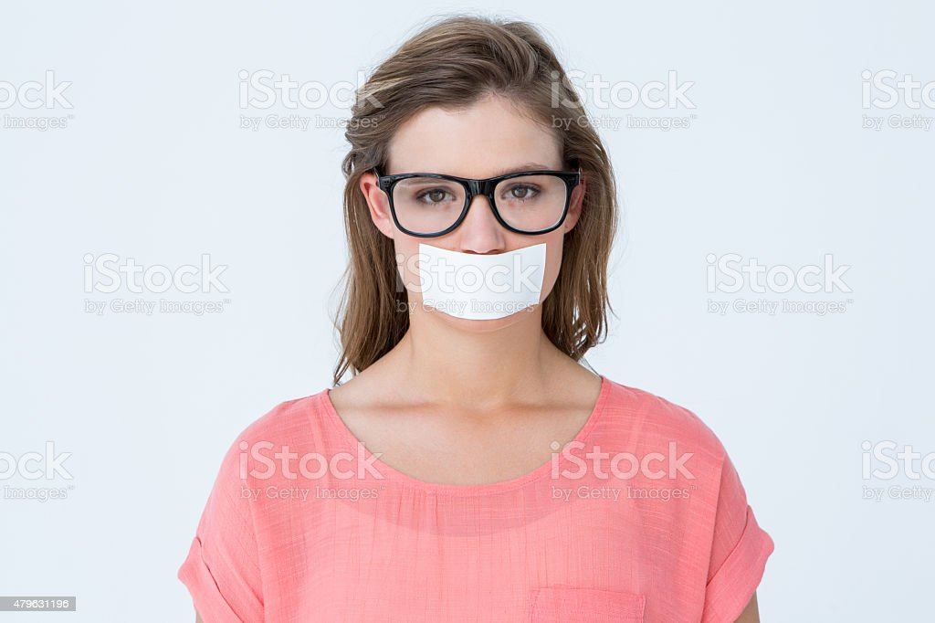 Geeky hipster with adhesive tape on mouth stock photo