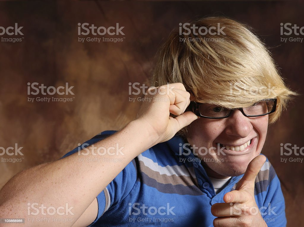 geeky teen thinking stock photo