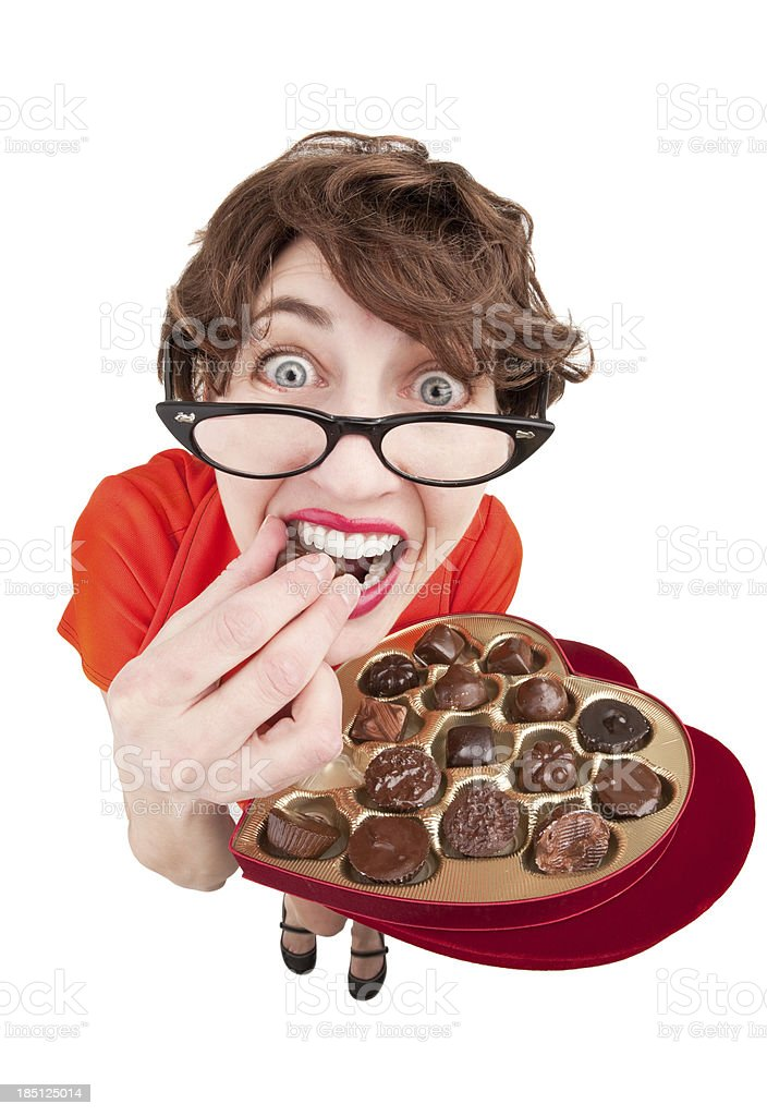 Geeky Woman Eating Chocolates royalty-free stock photo