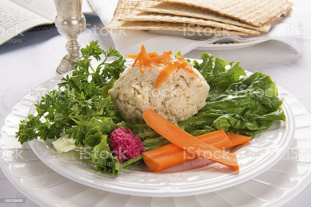 Gefilte Fish with Kidduch Cup, Matzah and Haggadah royalty-free stock photo