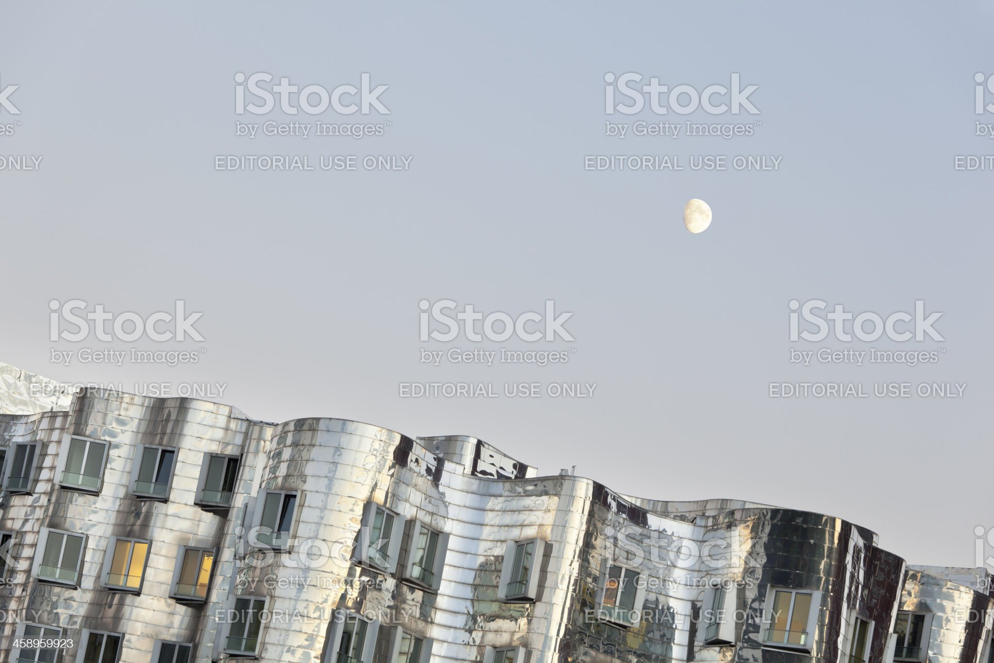 Gehry Building And Moonrise royalty-free stock photo