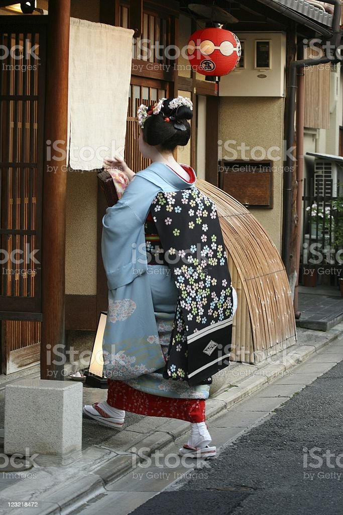 Geiko entering the teahouse in Gion royalty-free stock photo