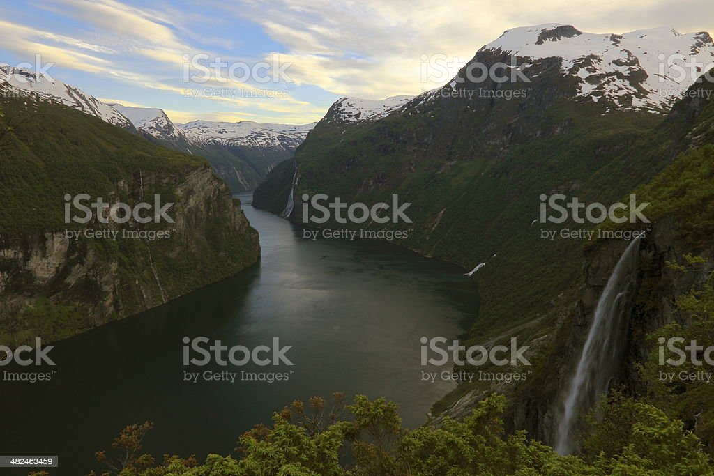 Geiranger fjord at dramatic sunset, Waterfall long exposure, Norway stock photo