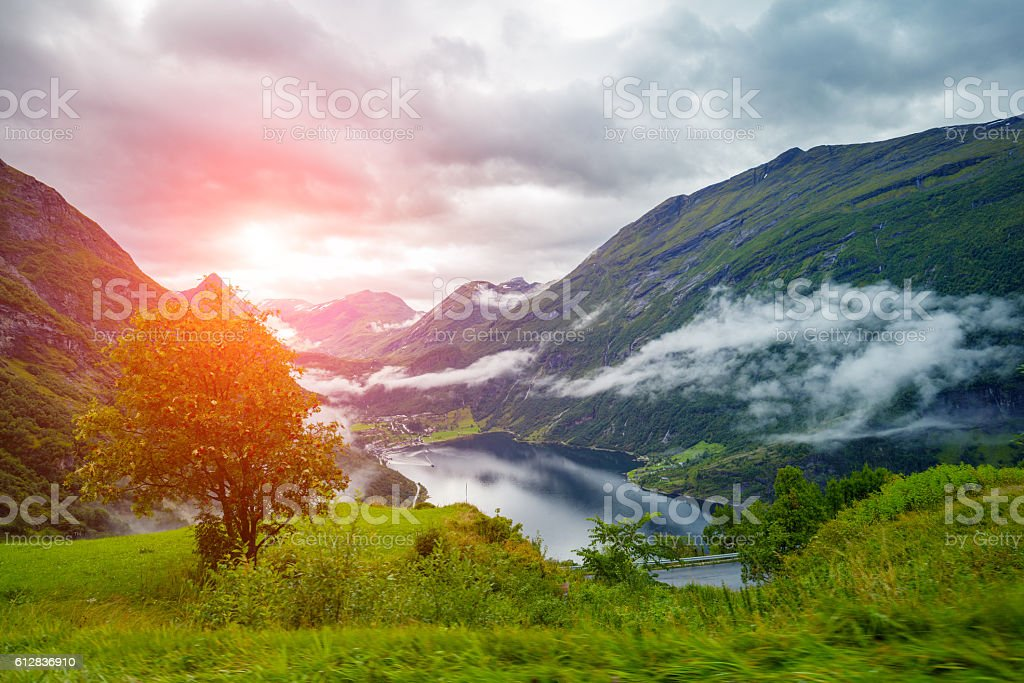 Geiranger fjord at sunset. Mountaint landscape in evening. Norway stock photo