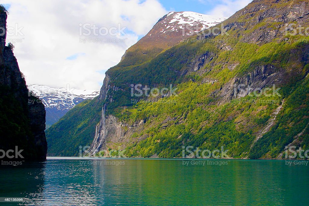 Geiranger fjord from cruise ship and seven sisters waterfall stock photo