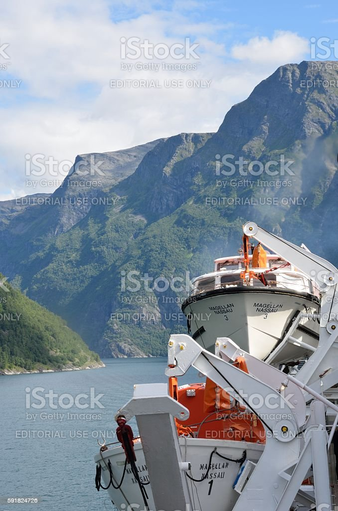 Geirangerfjord  Norway from rear of cruise ship Magellan with lifeboats stock photo