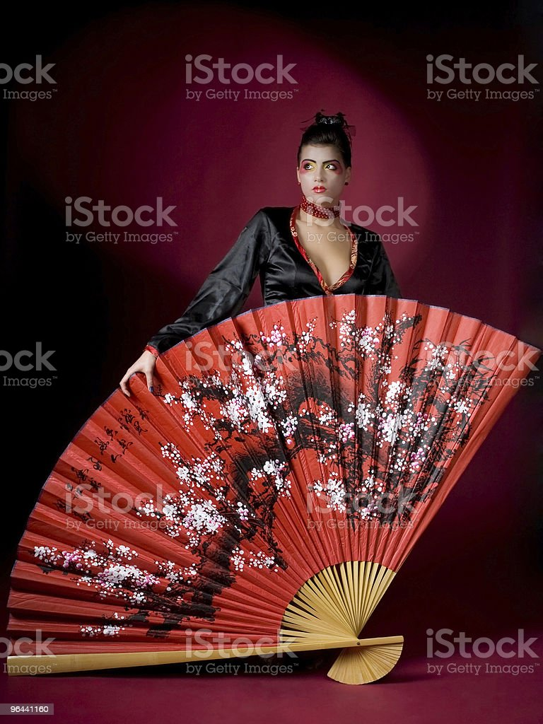 Geisha holding a huge painted fan royalty-free stock photo