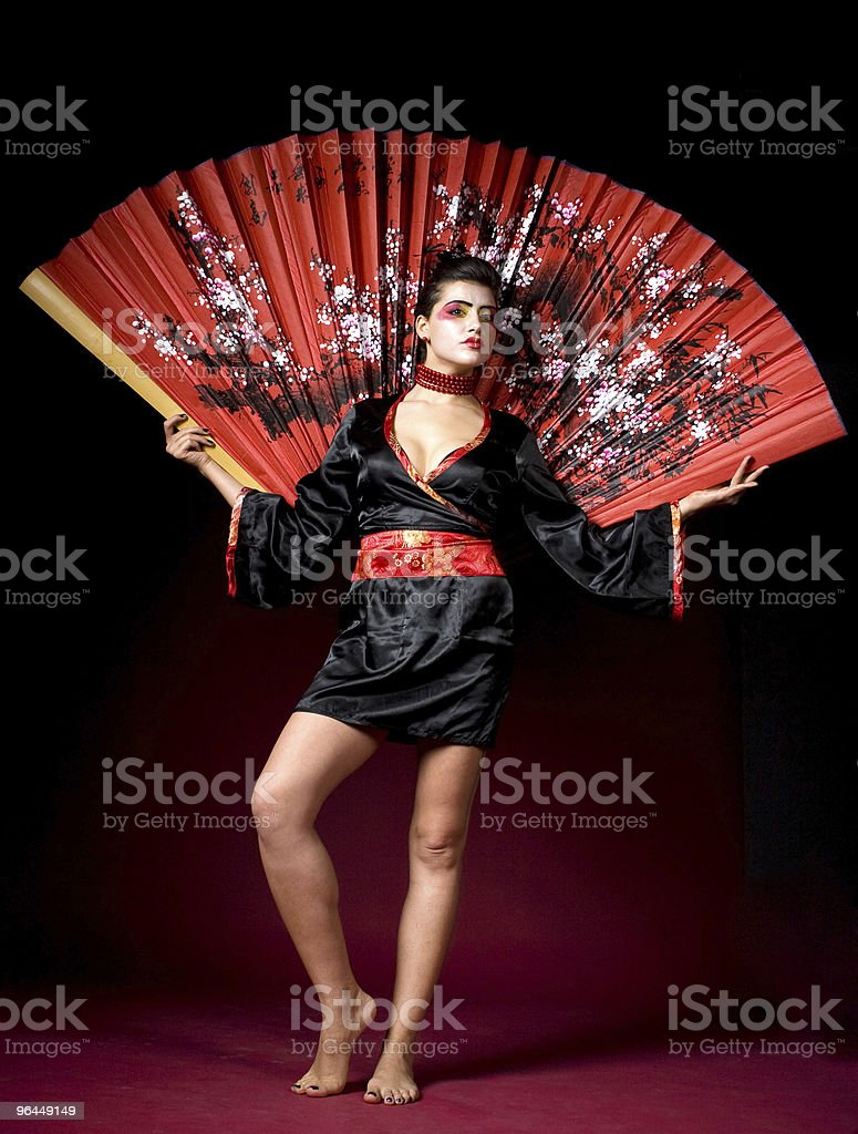 Geisha holding a huge painted fan stock photo
