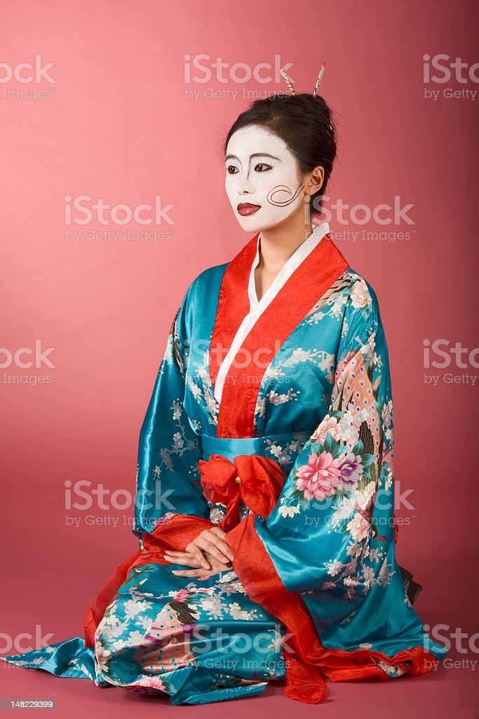 Geisha Japanese woman in kimono and facepaint royalty-free stock photo