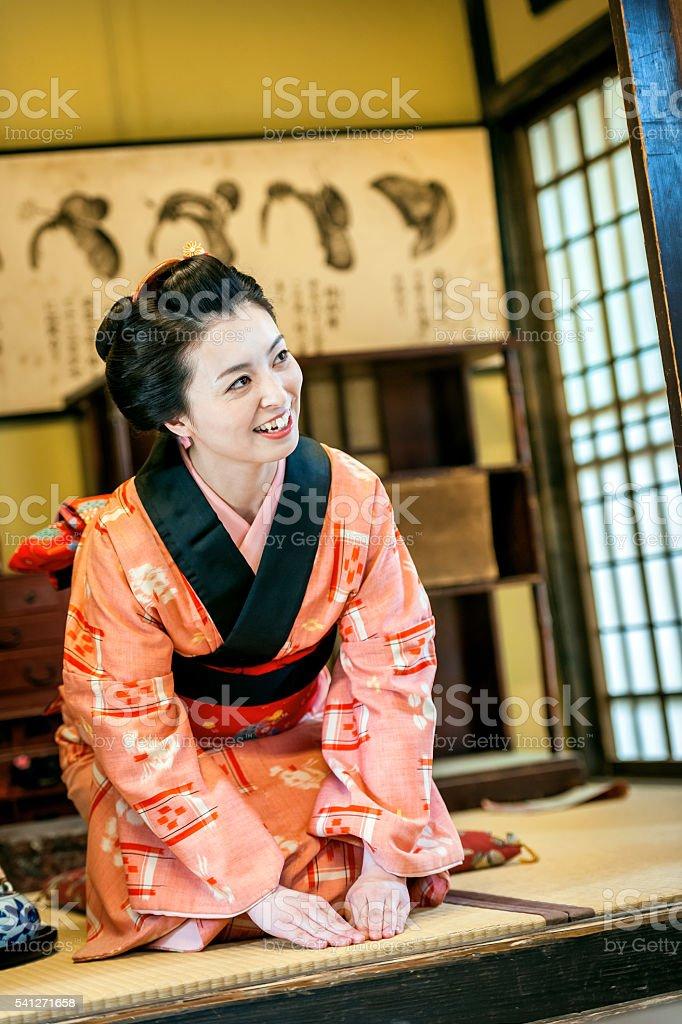 Geisha welcomes the friend who is leaving,Kyoto,Japan stock photo