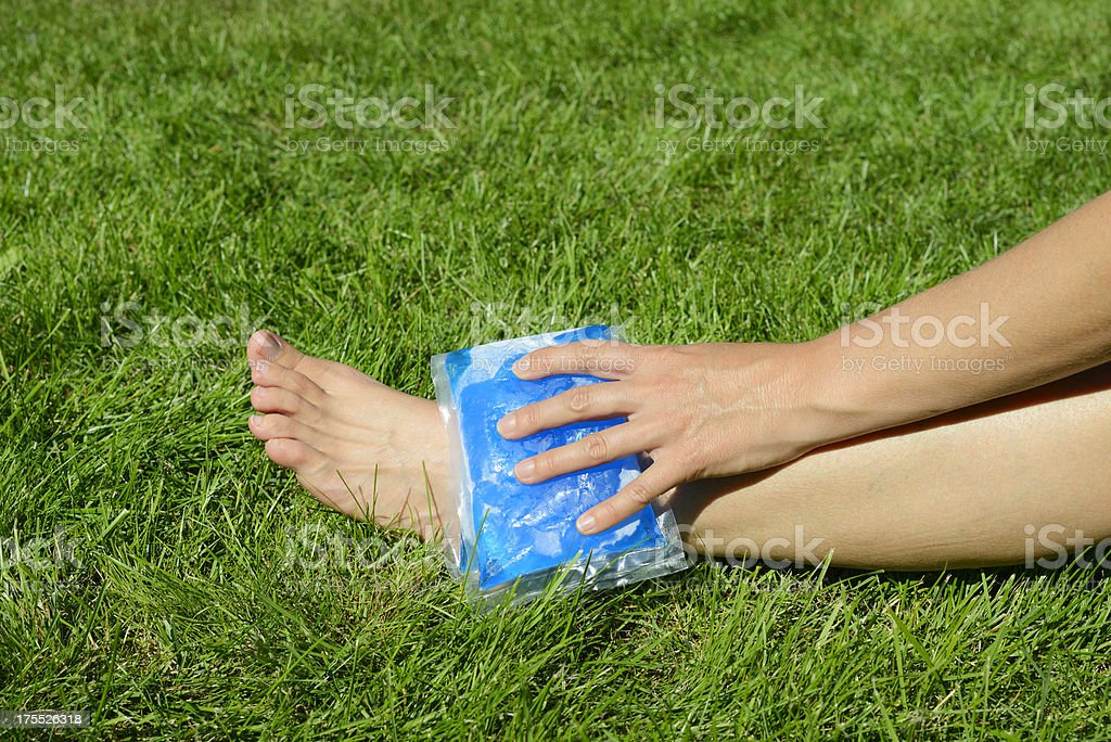 gel pack on ankle stock photo