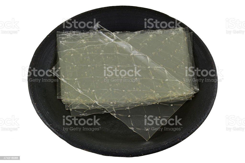 Gelatin leaves on a dark ceramic plate stock photo