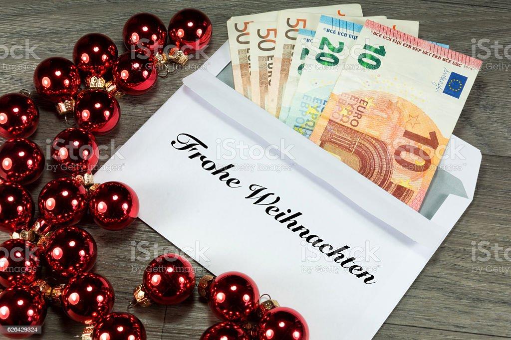 Geld und Frohe Weihnachten stock photo