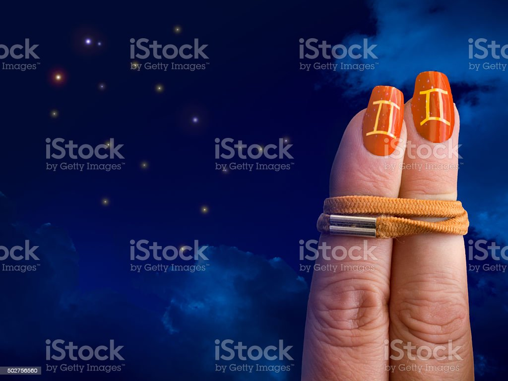 Gemini orange nails stock photo