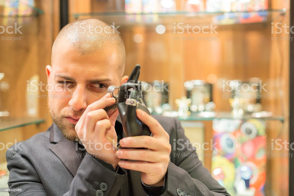 Gemologist inspecting Jewelry stock photo
