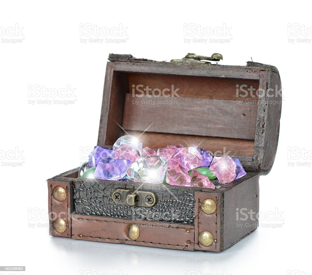 Gems in the open wooden chest stock photo