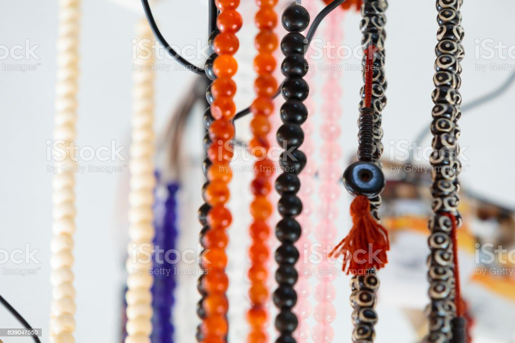 Gemstone and pearl necklaces in a jewellery shop stock photo