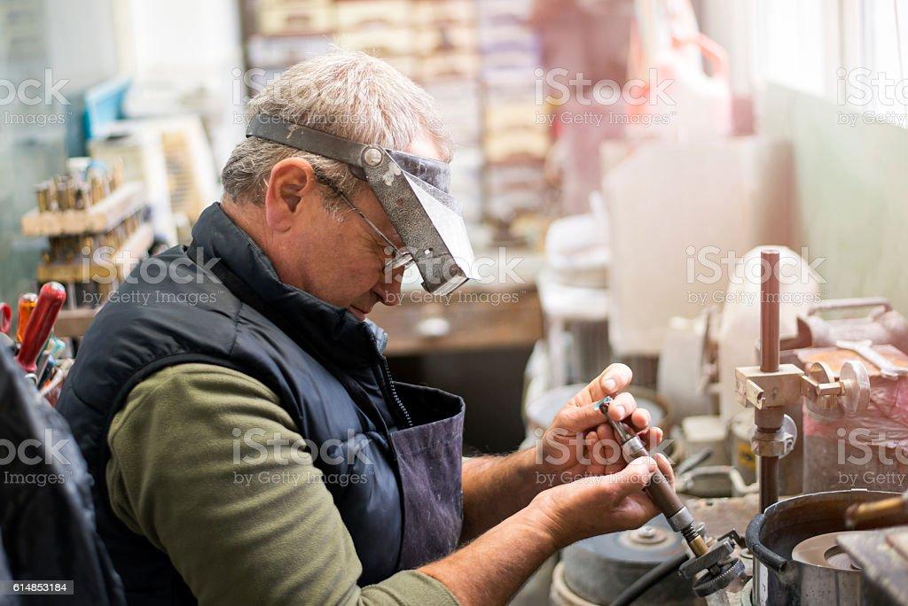 Gemstone grinding stock photo