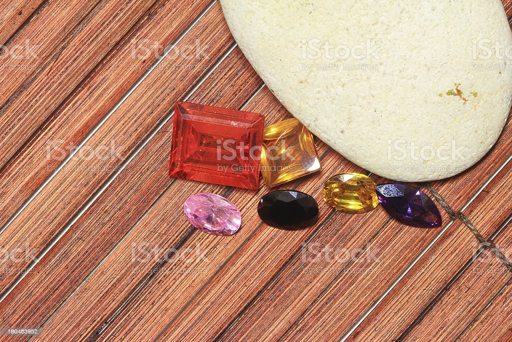Gemstone on wood background royalty-free stock photo